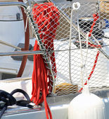Red rope to moor a yacht in the harbor — Stock Photo