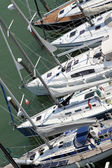 Luxurious and expensive yachts and motor boats moored in the tou — Stock Photo