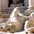 Fountain of trevi in Rome with the runaway horse statue symboliz — Stock Photo