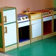 Stock Photo: Wooden toy kitchen to play and amuse children of nursery