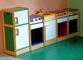 Wooden toy kitchen to play and amuse the children of a nursery — Stock Photo