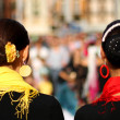 Heads of two women with very hairstyle and a yellow and red scar — Photo