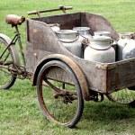Rusty bikes of ancient milkman with aluminium drum — Stock Photo #32069763