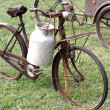 Rusty bikes of ancient milkman with aluminium drum — Stock Photo