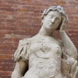 Statue with headaches with brick background — Stock Photo #32069783