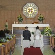 Christian Church during the rite of marriage with a yellow rose — Stock Photo