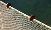 Net intact without fish but with some floats on the edge — Stock Photo