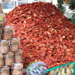 Stock Photo: Immense mountain of dried red ripe tomatoes for sale