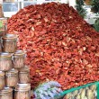Immense mountain of dried red ripe tomatoes for sale — Stock Photo
