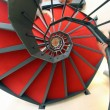 Spiral staircase with red carpet for a dizzying ascent — Stockfoto