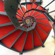 Spiral staircase with red carpet for a dizzying ascent — 图库照片