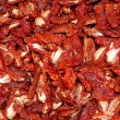 Stock Photo: Dried red ripe tomatoes for sale at vegetable market