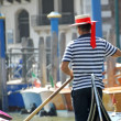 Gondolier as he drives his gondola — Stock Photo