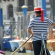 Gondolier as he drives his gondola — Stock Photo #32568913