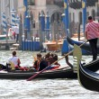 Skilled Venetigondolier as he drives his gondola — Stock Photo #32568947