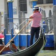 Venetian gondolier pilot his gondola — Stock Photo