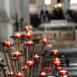 Red candles inside a church — Stockfoto