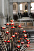 Red candles inside a church — Stock Photo