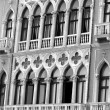 Ancient balcony in Venetian style with arched windows of a histo — Stock Photo