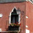Flowery balcony in Venetian style with arched windows of a histo — ストック写真