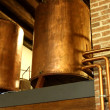 Stock Photo: Copper tanks and tubes in production of whiskey