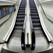 Wide escalator that goes up inside a business centre — Stock Photo