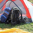 Stock Photo: Backpacks of hikers resting above tent