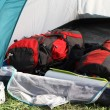 Stock Photo: Backpacks in tent and aluminum lunchbox