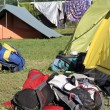 Backpacks of hikers in the midst of camping tents — Foto de Stock