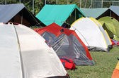 Encampment of tents in a soccer field — Stock Photo