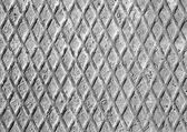Grey metal grill and rusty iron diamonds — Stock Photo