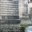 Stock Photo: Pillars of the bridge over the River Tiber in Rome