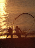 Two fishermen dragging the net — Stock Photo