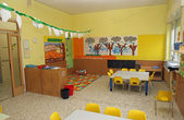 Classroom in a kindergarten with tables and yellow chairs — Stock Photo