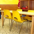 Particular of a classroom in a kindergarten with little yellow c — Stock Photo #34386031