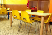 Particular of a classroom in a kindergarten with little yellow c — Stock Photo