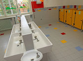 Small bathrooms of children in a nursery and low sinks — Stock Photo