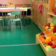 Nursery with stand and wooden kitchen toy — Стоковая фотография