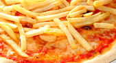 Original Neapolitan pizza with French fries and mozzarella and t — Stock Photo