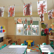 Nursery class of children with many drawings of trees hanging fr — Stock Photo
