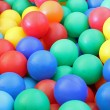 Closeup of brilliant colored plastic balls — Stock Photo