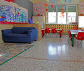 Blue sofa and Red chairs in a class of a kindergarten — Stock Photo