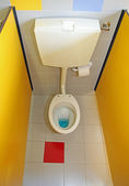 Toilet bowl water very small for children with yellow walls — Stock Photo