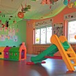 Slide and plastic tunnel in the playroom — Stock Photo