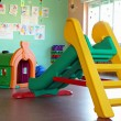 Slide and plastic tunnel in the playroom of a preschool — Stock Photo