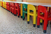 Line of colored plastic chairs in the refectory of the nursery — 图库照片
