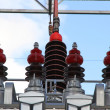 Big insulators of a voltage transformer of a powerful power plan — Stock Photo