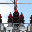 Big insulators of a voltage transformer of a powerful power plan — Stock Photo #35906535