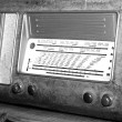 Stock Photo: Superheterodyne transistor radio under name of radio station