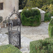 Stock Photo: Ancient well in cured Italian-style garden of villa